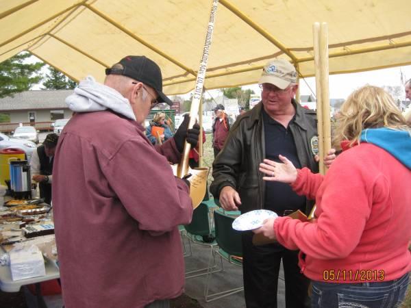 John McGuirk and John Ketcher sign a shovel