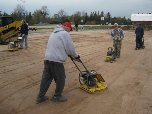 Compacting the sand